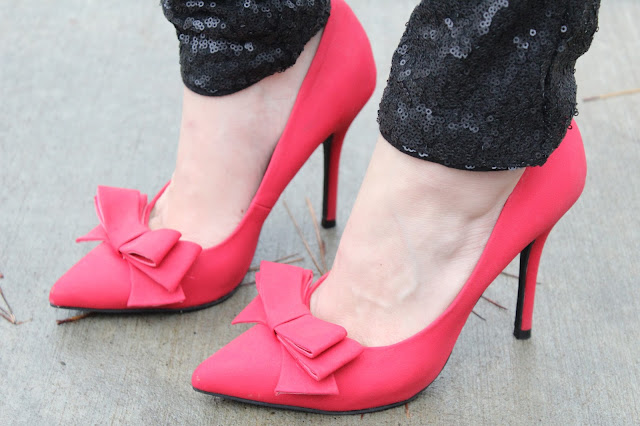 Red bow heels, black sequin pants