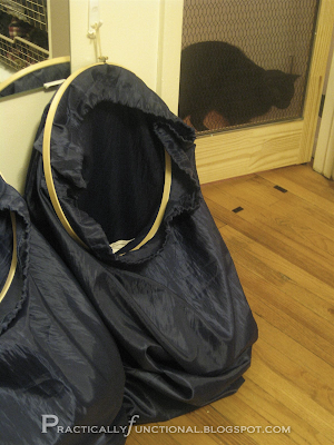 Laundry bags held open with embroidery hoops