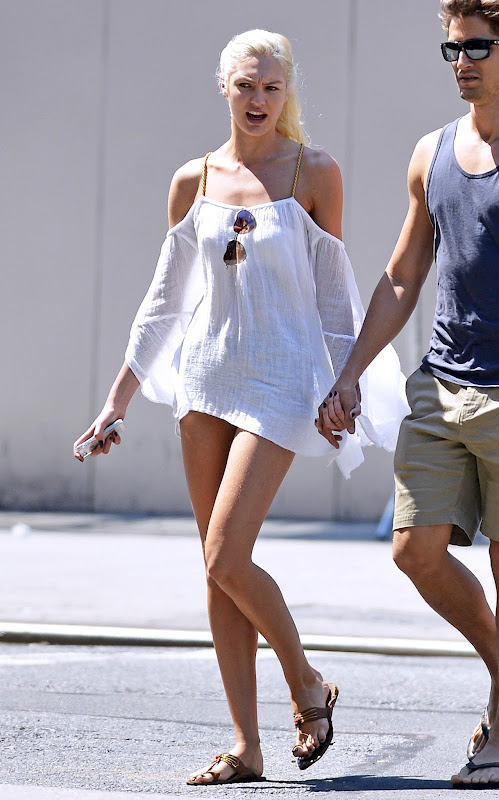 Candice Swanepoel leggy in short shorts