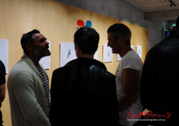 Patrons view STEREOGENIC at Black Eye gallery. Photo by Kent Johnson.
