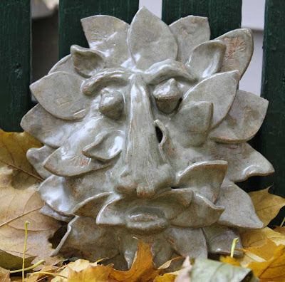 glazed sculpted clay tree face