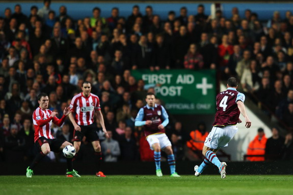 Aston Villa captain Ron Vlaar shoots and scores the opening goal against Sunderland