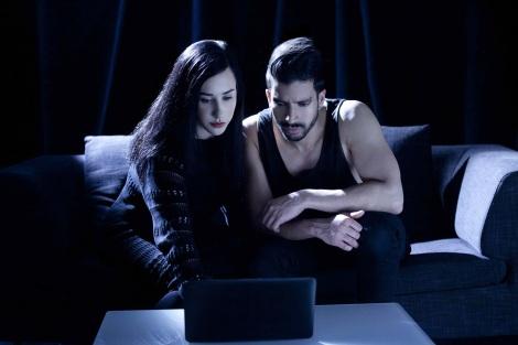 Nik Thakkar and Ada Zandition sitting by laptop