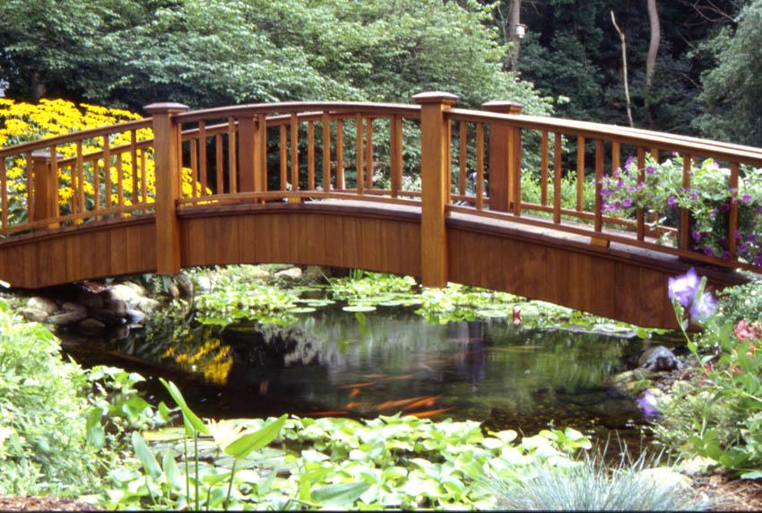 Aquascape your landscape bridge over un troubled waters for Fish pond bridges