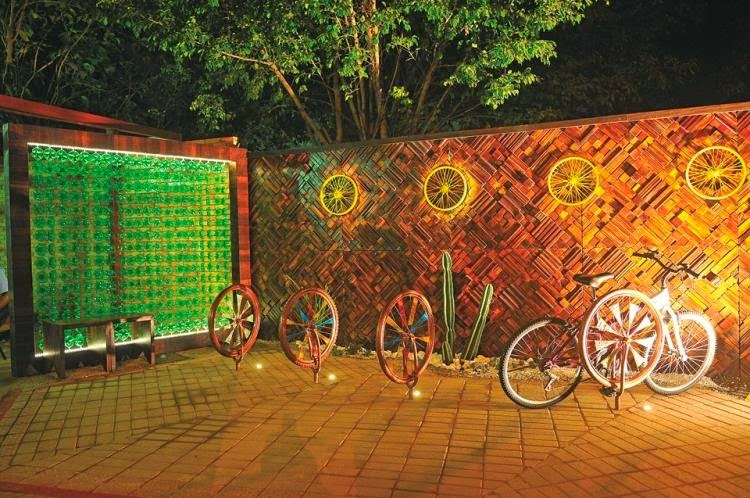 Decorative Bicycle Wheel Plastic Bottles Pieces Of Wood Garden Fence Panels.
