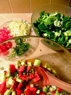 Bowl of marinating veggies, plate of toppings, plate of greens
