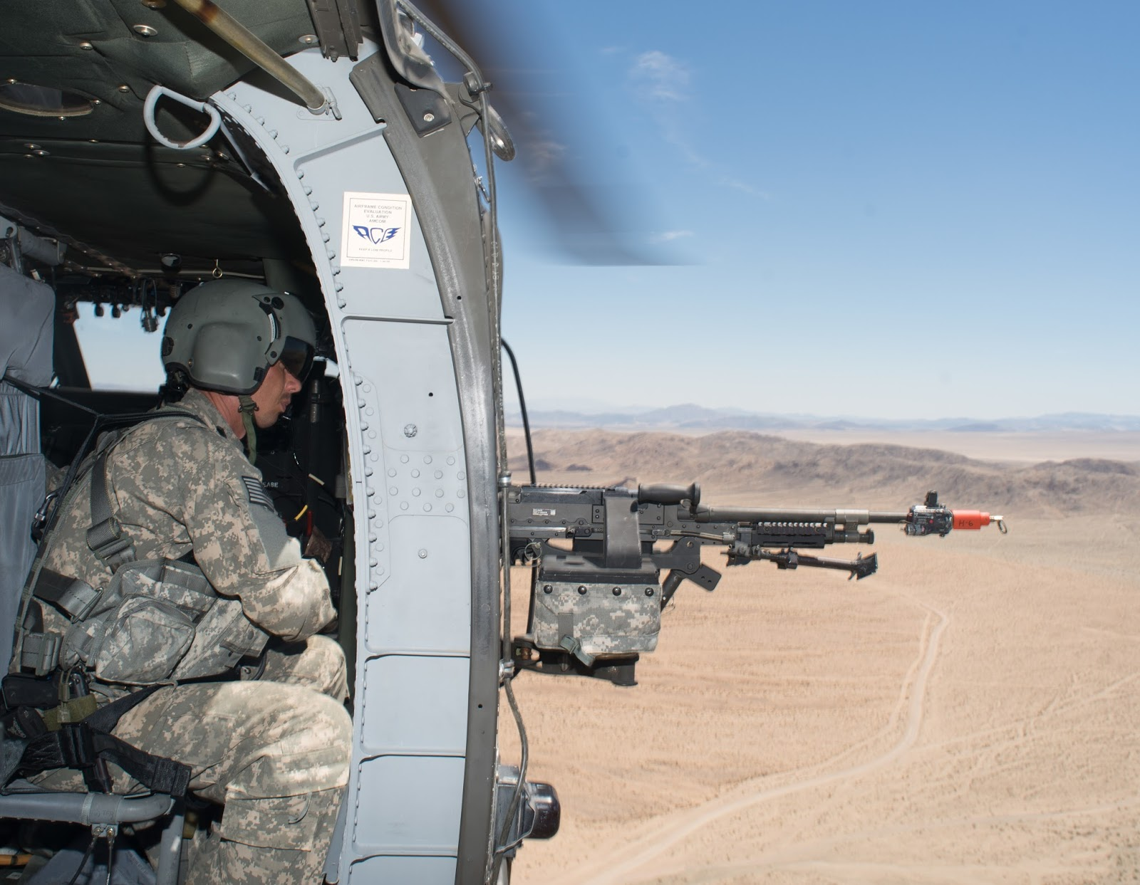 idaho army national guardsman sgt keo markwell crew chief from a company 1st battalion 183rd aviation reconnaissance battalion scans the terrain with