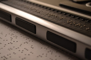 A braille display and a page of braille dots