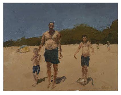 Padre con niños en la playa