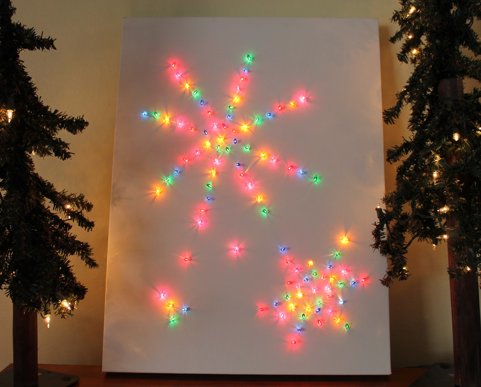 You may need to secure the string between the lights to the back of the canvas so it doesnu0027t stick out so far that you canu0027t hang it on a wall. & Desperate Craftwives: Christmas Light Canvas