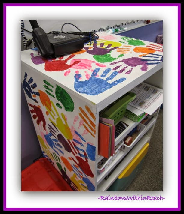 Painted Hand Prints Decorate Classroom Shelf {Hand Print RoundUP at RainbowsWithinReach}