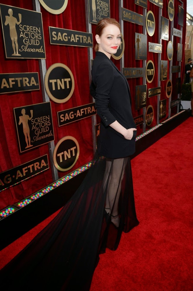 Emma Stone in a Christian Dior Couture tuxedo gown at the 21st Annual SAG Awards in LA