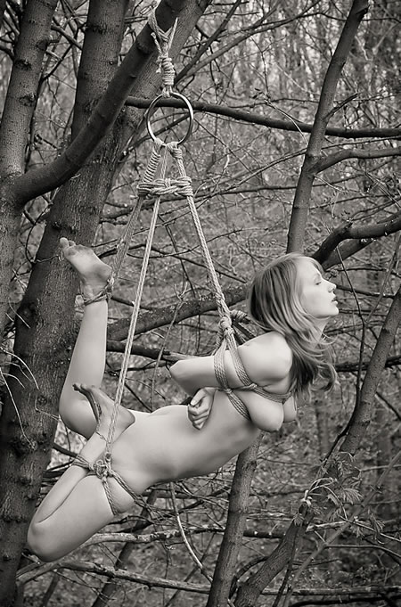 Shoulders Women bound to a tree remarkable words
