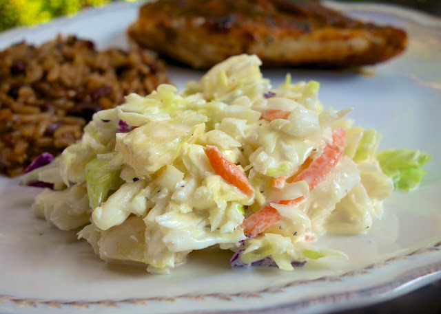 Pineapple Slaw Recipe - cabbage, pineapple, vinegar, sugar and mayonnaise. So simple and tastes amazing! Inspired by our trip to the beach. Pompano Joe's copycat recipe. Great for a potluck.