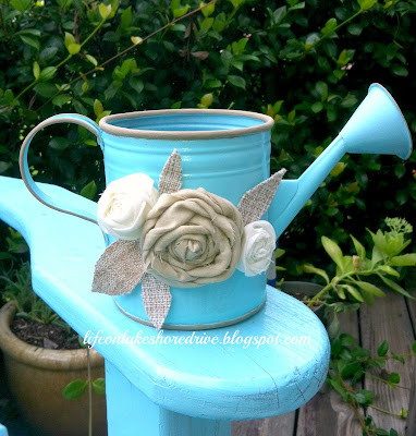 Blue Watering Can Makeover with Rosettes