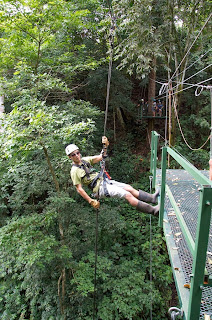 After climbing the waterfall and zip lining to the next platform, you have to rappel down.
