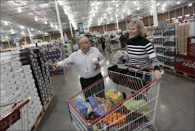 Costco CEO Jim Sinegal touring warehouse location