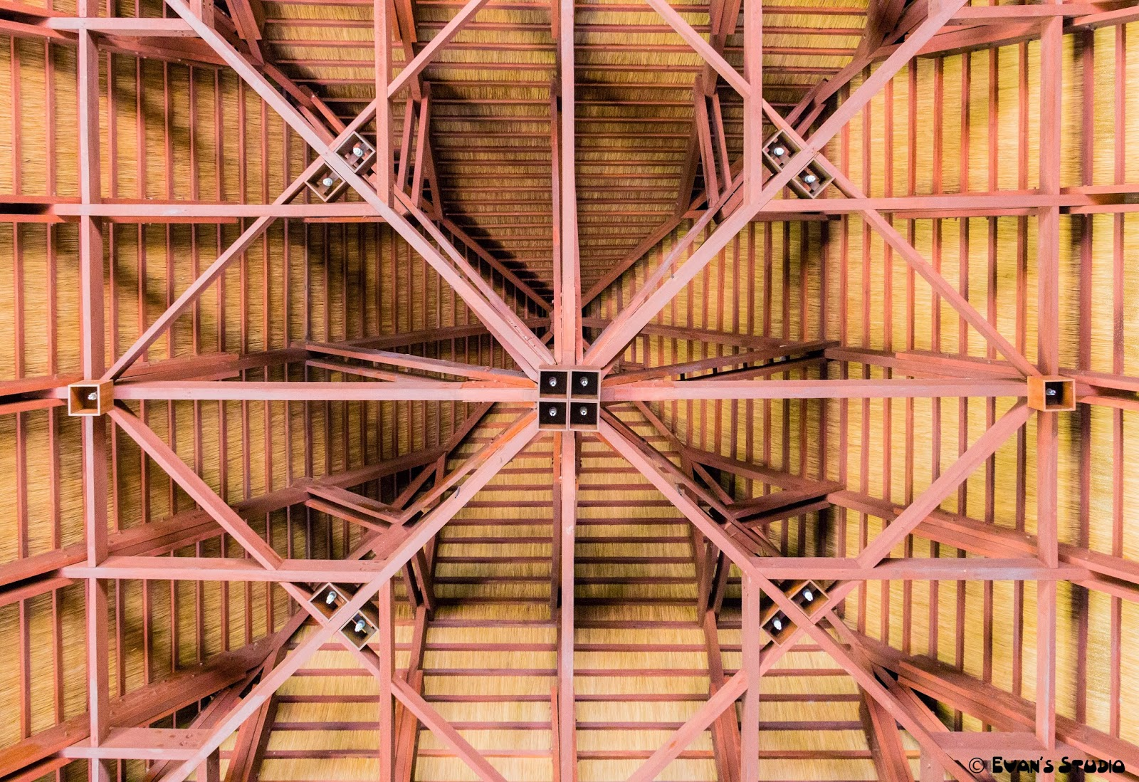 An image showing the interesting symmetrical patterns of the ceiling of Apulit Island Resort's dining hut.