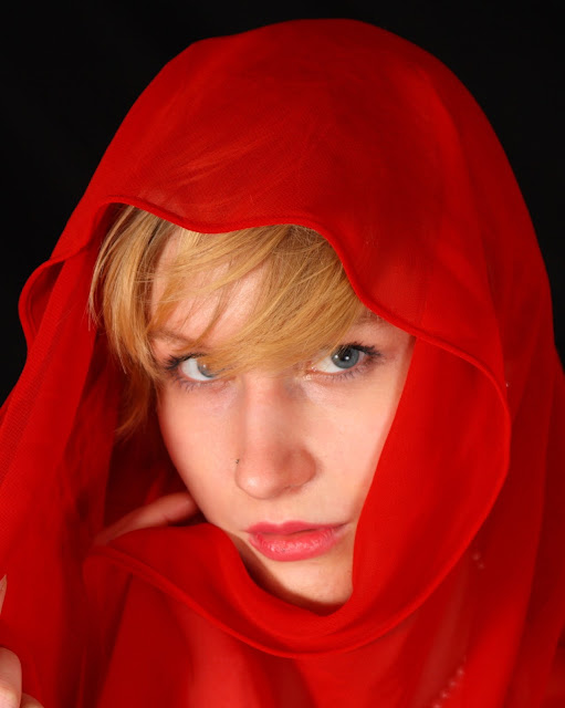 Pretty girl in a red scarf portrait - ready for B&W conversion (grayscale).