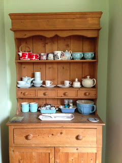 Welsh dresser full of tea pots and cups