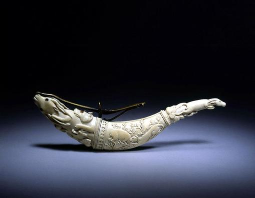 ... finely carved Portuguese powder-horn dating to the Late 19th Century