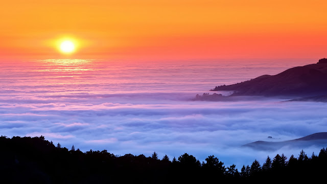 Sunset fog over sea mountains HD Wallpaper
