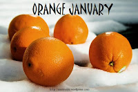 picture of oranges resting on white snow, with 'Orange January' written at top of the image