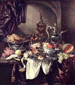 Still life with fruit, roast, silver- and glassware, porcelain and columbine cup on a dark tablecloth with white serviette - a famous painting by Abraham van Beijeren