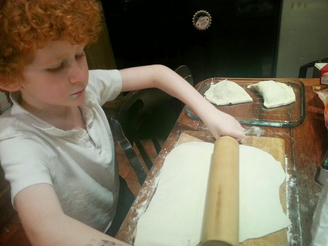 six year old cooking making a pie