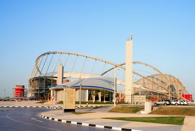 A road leads into Qatar's Khalifa Stadium.