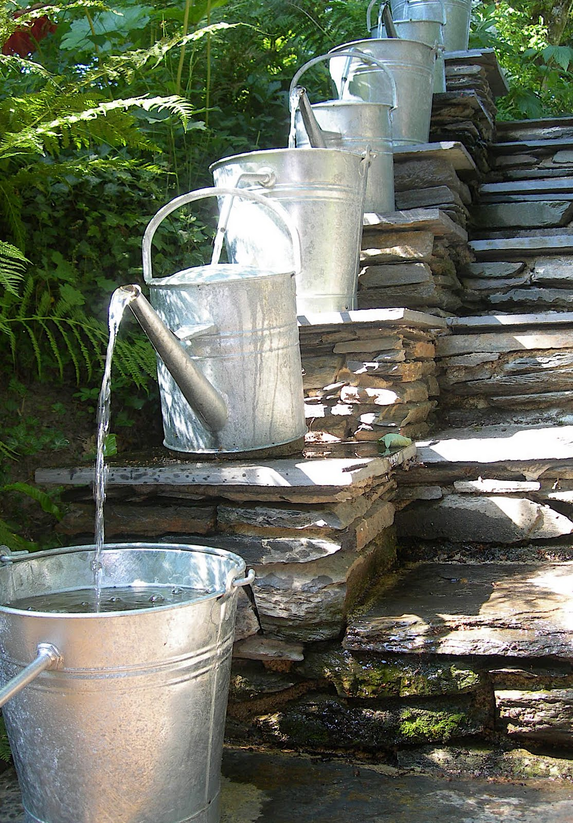 Pilgrim and pie in france water feature with watering cans for Waterfall fountain