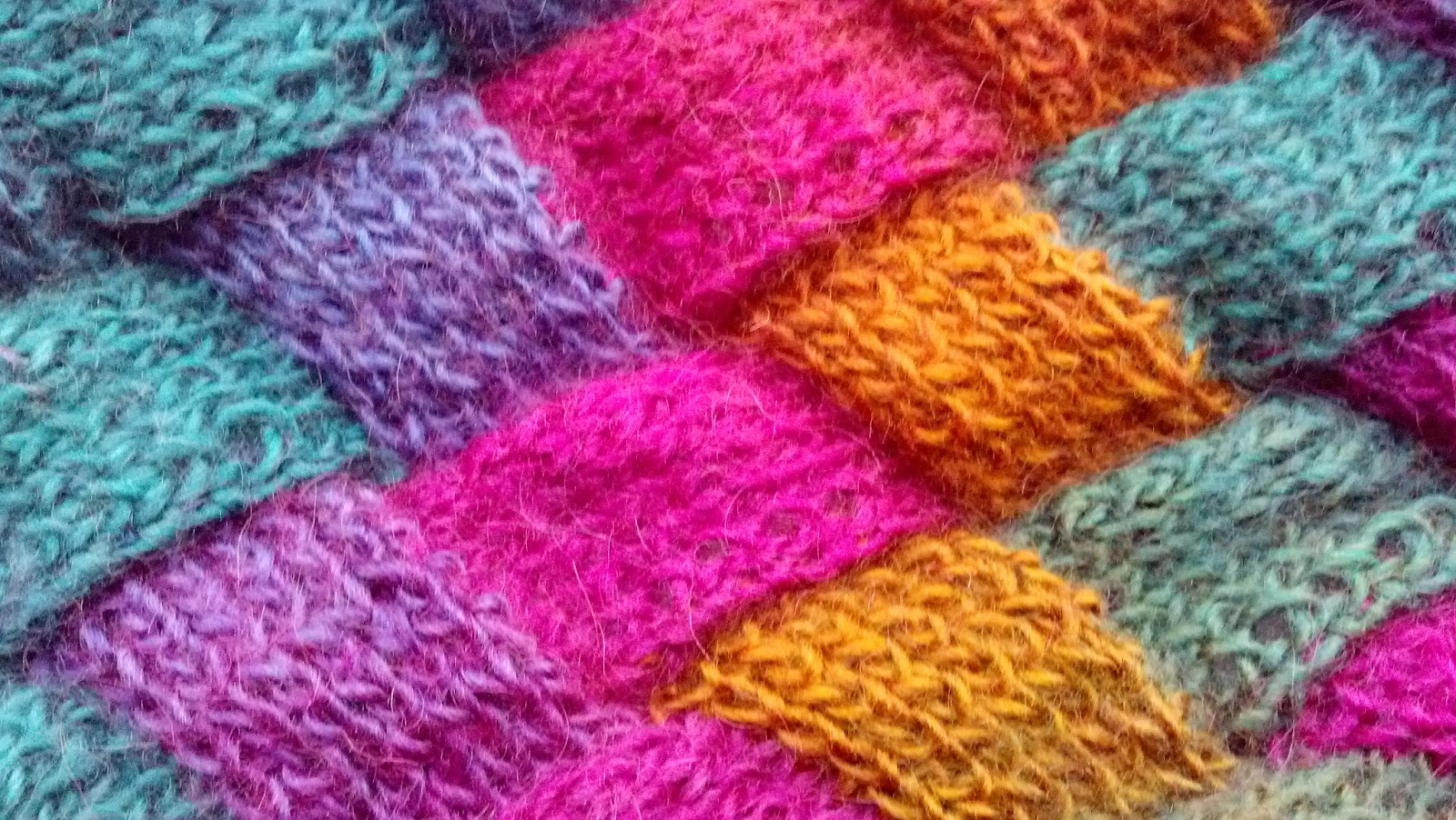 Entrelac scarf knit a bit crochet away pattern available here this is a great pattern for entrelac beginners and it explains the process well it can take a bit to wrap your brain around how the bankloansurffo Gallery
