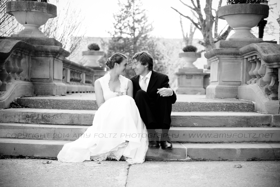 photo of bride and groom sitting on steps at St. Mary-of-the-Woods College