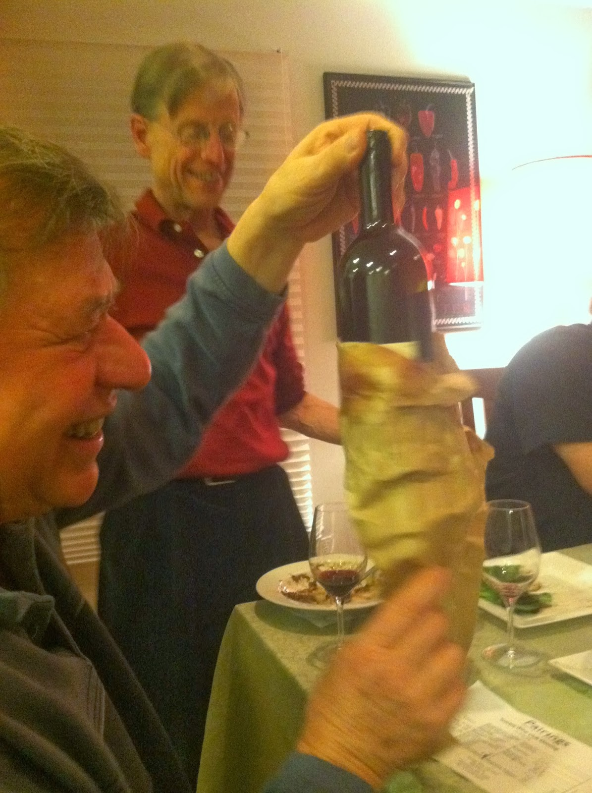 Revealing a Super Tuscan from its paper bag at a wine club blind tasting. Cooking Chat post.