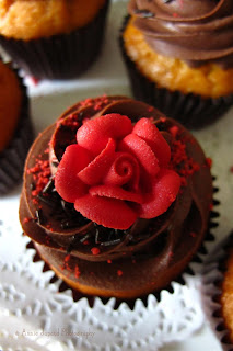 chocolate cupcake with red rose for decoration