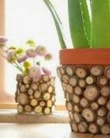 http://portaldemanualidades.blogspot.com.es/2013/10/macetas-decoradas-con-madera.html