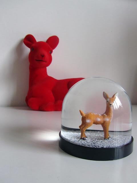 deer in a snow ball