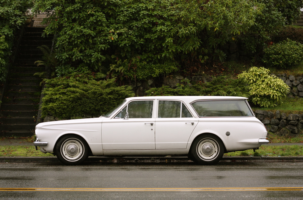 OLD PARKED CARS.: 1964 Plymouth Valiant Wagon.