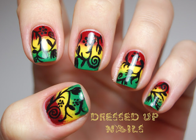 Dressed Up Nails - freehand floral silhouette nail art over a rasta-color gradient