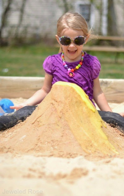 Making a sand volcano is tons of fun for kids!  You can easily set this activity up at the beach or right in your sand box.