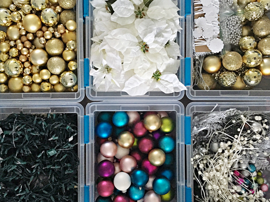 garland was stored in two bins ribbon and tree embellishments were in another bin bulb ornaments were in their own bins