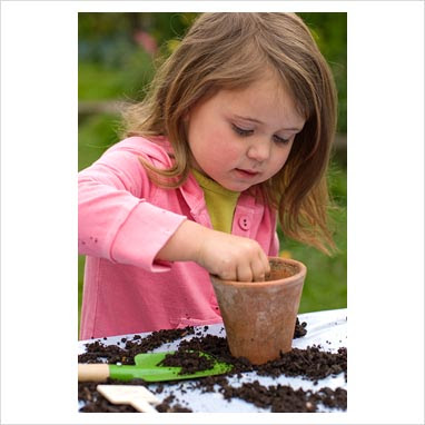 Cute little baby girl planting flowers images free download