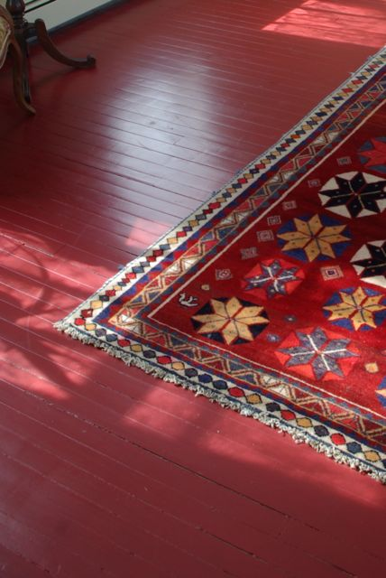 We had managed to save our original hardwood floor and it was a brilliant  shade of deep red.