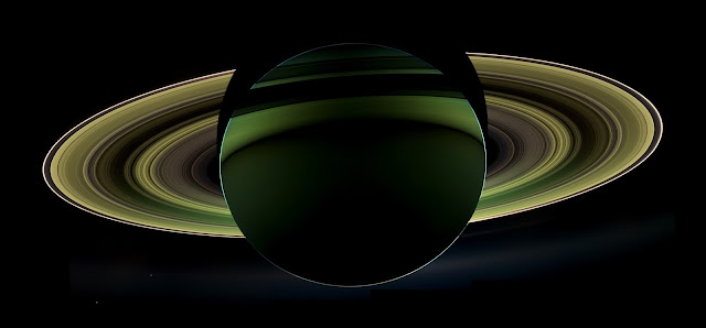 "NASA's Cassini spacecraft has delivered a glorious view of Saturn, taken while the spacecraft was in Saturn's shadow. The cameras were turned toward Saturn and the sun so that the planet and rings are backlit. (The sun is behind the planet, which is shielding the cameras from direct sunlight.) In addition to the visual splendor, this special, very-high-phase viewing geometry lets scientists study ring and atmosphere phenomena not easily seen at a lower phase.   Since images like this can only be taken while the sun is behind the planet, this beautiful view is all the more precious for its rarity. The last time Cassini captured a view like this was in Sept. 2006, when it captured a mosaic processed to look like natural color, entitled ""In Saturn's Shadow."" In that mosaic, planet Earth put in a special appearance, making ""In Saturn's Shadow"" one of the most popular Cassini images to date. Earth does not appear in this mosaic as it is hidden behind the planet.   Also captured in this image are two of Saturn's moons: Enceladus and Tethys. Both appear on the left side of the planet, below the rings. Enceladus is closer to the rings; Tethys is below and to the left.   This view looks toward the non-illuminated side of the rings from about 19 degrees below the ring plane.   Images taken using infrared, red and violet spectral filters were combined to create this enhanced-color view. The images were obtained with the Cassini spacecraft wide-angle camera on Oct. 17, 2012 at a distance of approximately 500,000 miles (800,000 kilometers) from Saturn. Image scale at Saturn is about 30 miles per pixel (50 kilometers per pixel).   The Cassini-Huygens mission is a cooperative project of NASA, the European Space Agency and the Italian Space Agency. The Jet Propulsion Laboratory, a division of the California Institute of Technology in Pasadena, manages the mission for NASA's Science Mission Directorate, Washington, D.C. The Cassini orbiter and its two onboard cameras were designed, developed and assembled at JPL. The imaging operations center is based at the Space Science Institute in Boulder, Colo.   Image Credit: NASA/JPL-Caltech/Space Science Institute Explanation from: http://www.nasa.gov/mission_pages/cassini/multimedia/pia14934.html"