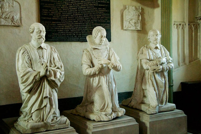 Three Kneeling Statues