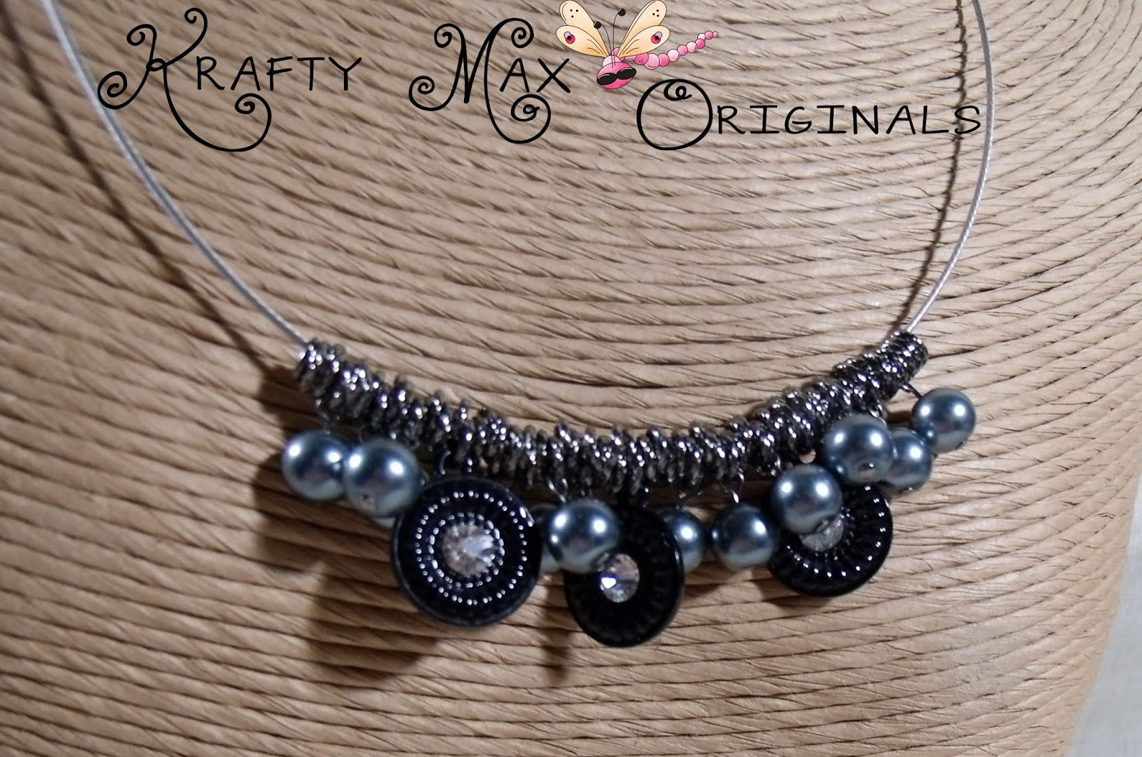 http://www.artfire.com/ext/shop/product_view/KraftyMax/8255624/black_and_grey_prima_beads_blog_team_necklace_-_a_krafty_max_original_/handmade/jewelry/necklaces/glass