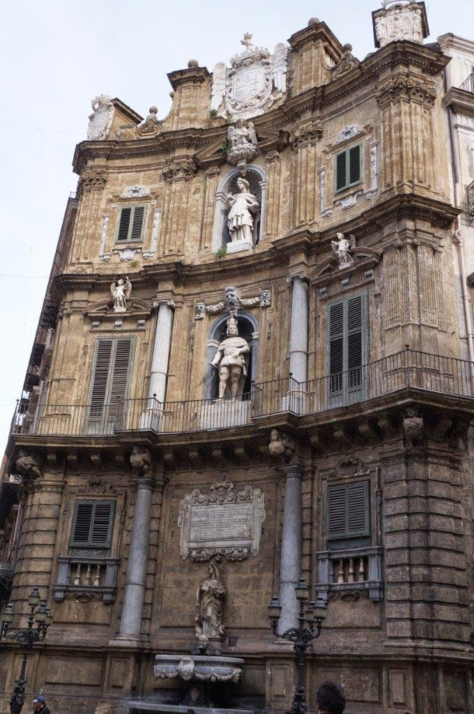 Beautiful stonework statues on a building in Palermo Sicily Italy.