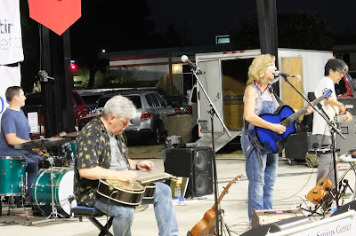 Terri Hendrix and her band play on stage in San Marcos, Texas at the city park.