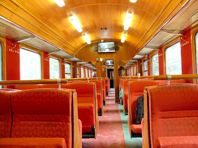 Newly refurbished interiors of the Flåm Railway coaches. You can see the monitors in each of the cars that recount your journey and provide historical background on the railway. Don't you love the colors?
