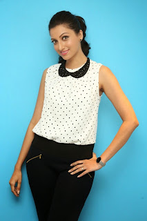 Hamsa Nandini Item Girl Beautiful White Polka Dotted Top and Black Denim Lovely Pics